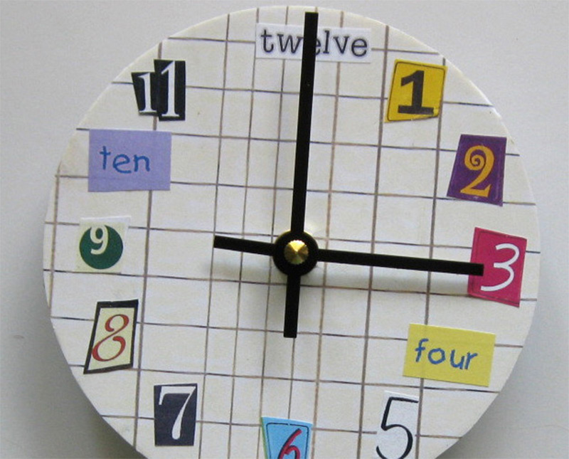 collaged numbers on ledger sheet wall clock design