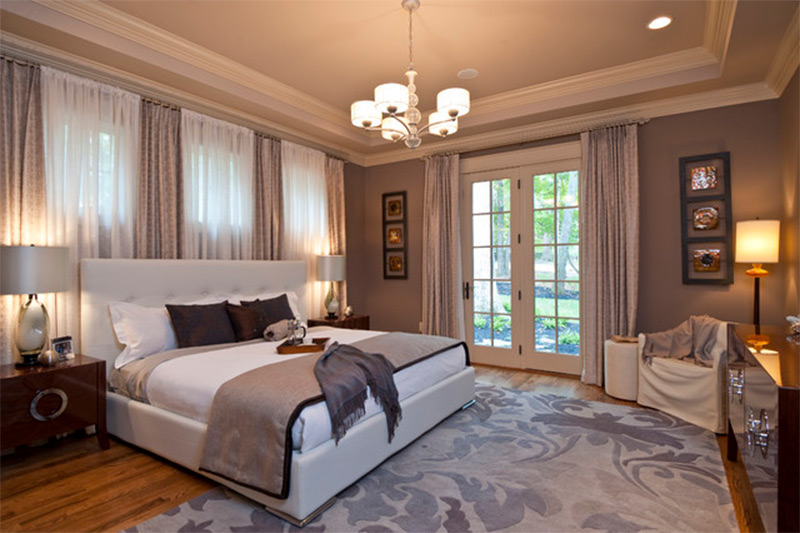 flat bed bedroom chandelier patio doors windows