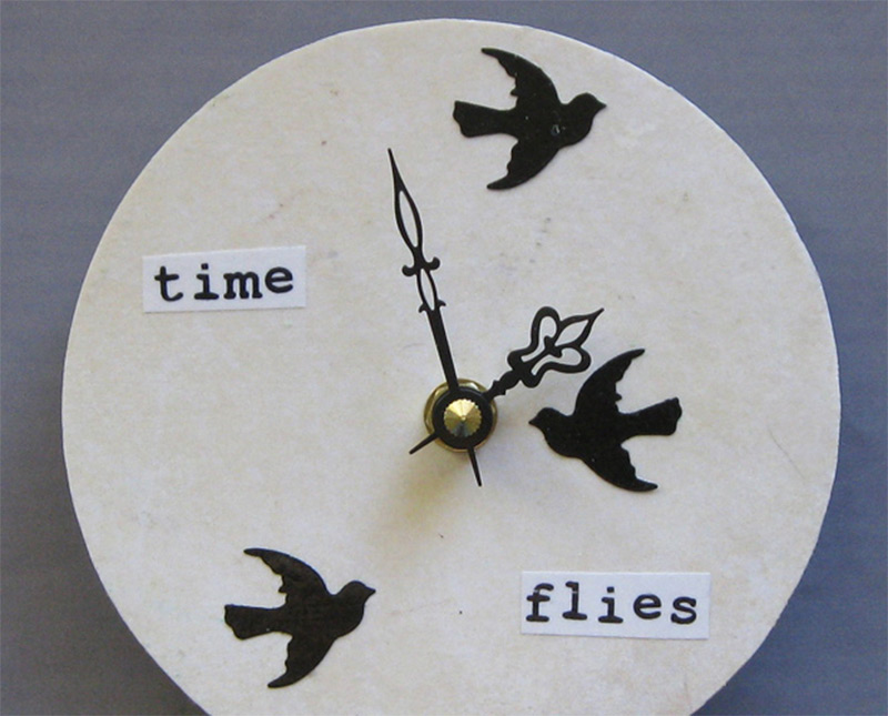 dark birds shadows wall clock round time flies
