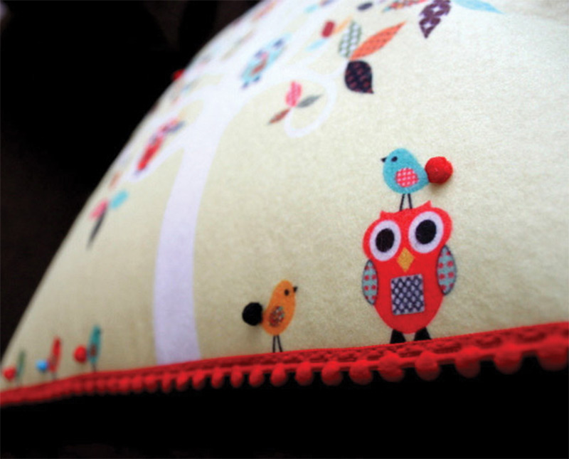yellow sewn characters animals pillow design