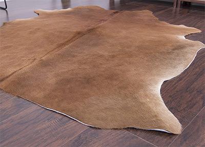 exotic brown cowhide rug