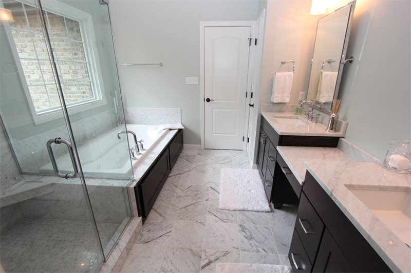 narrow master bathroom black and white