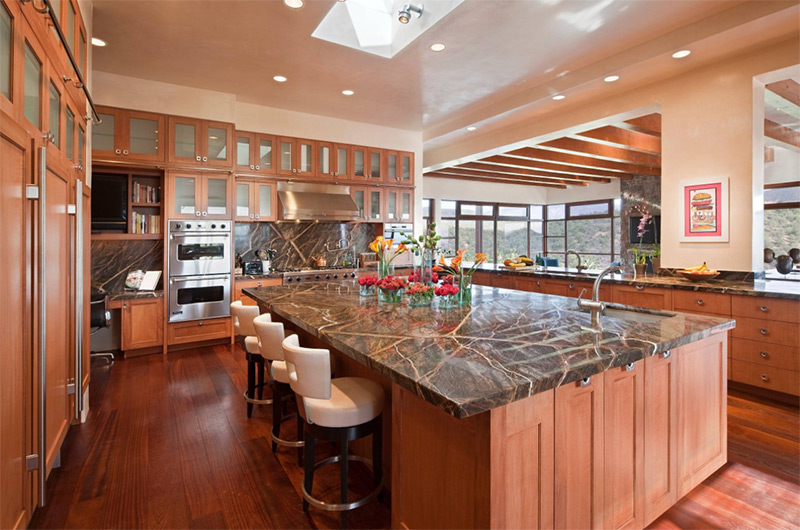 southwestern style kitchen with passthrough