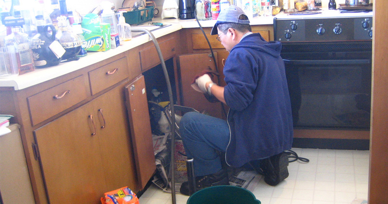 Plumber working on the pipes