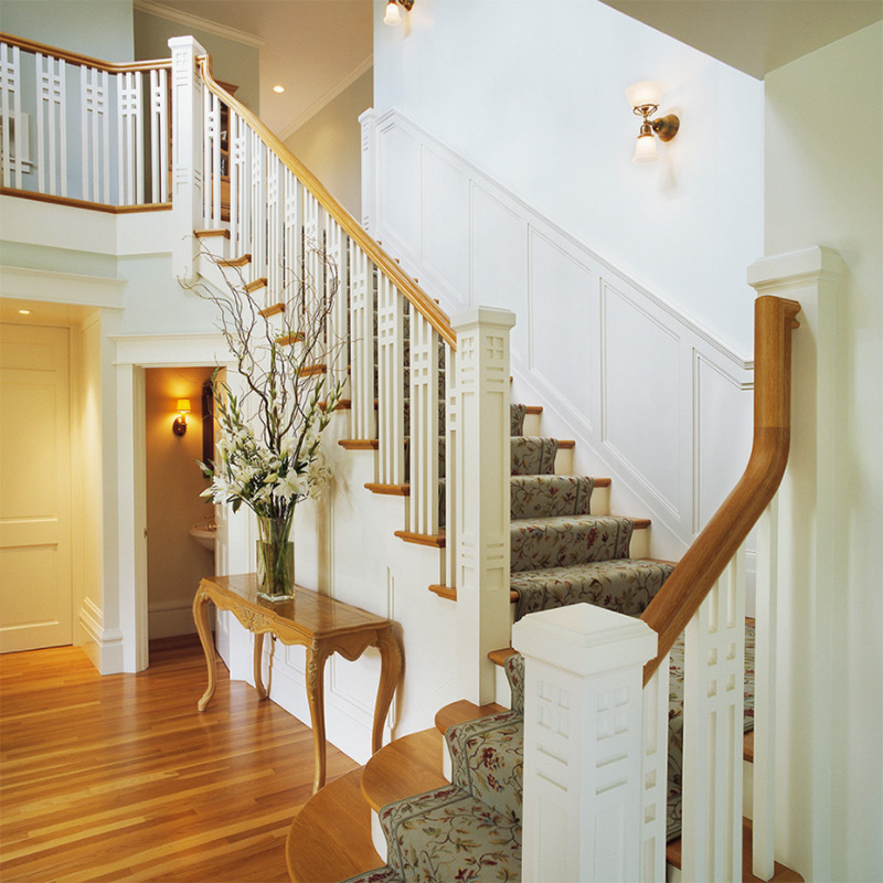 Angled carpeted staircase interior