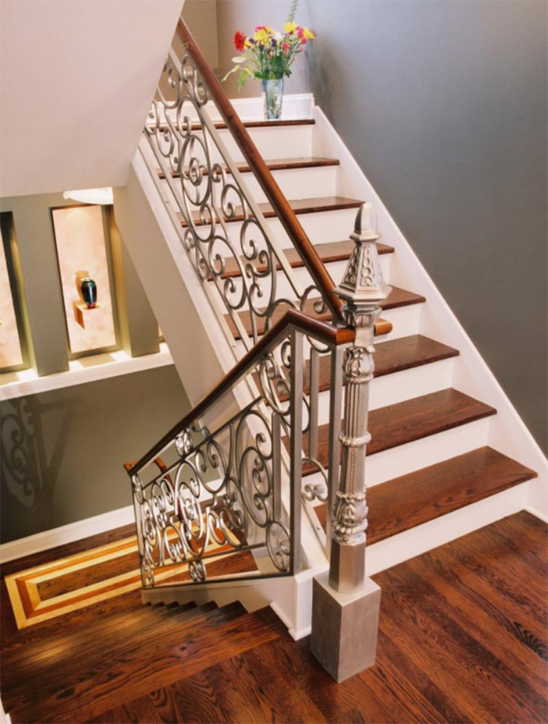 Dark wood curved landing staircase
