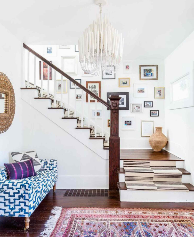 eclectic staircase landing with a vase