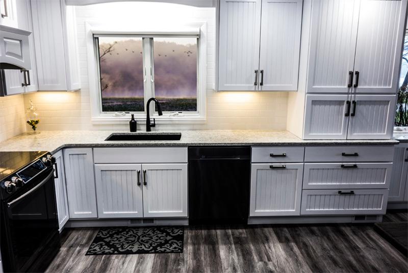 Dark sink white kitchen