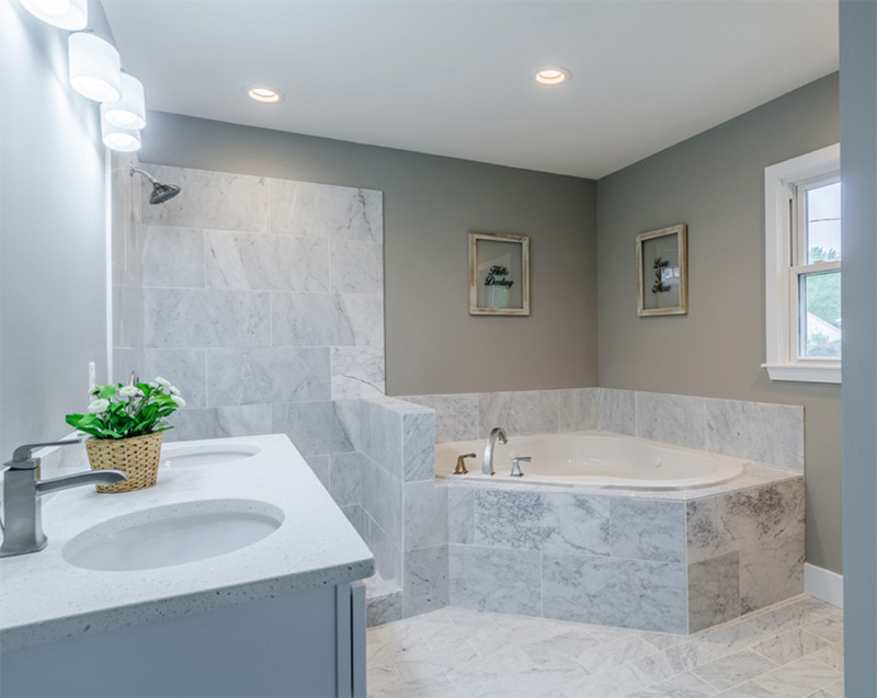 Midcentury bathroom with corner bathtub