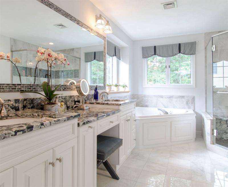 Bright white bathroom with corner tub