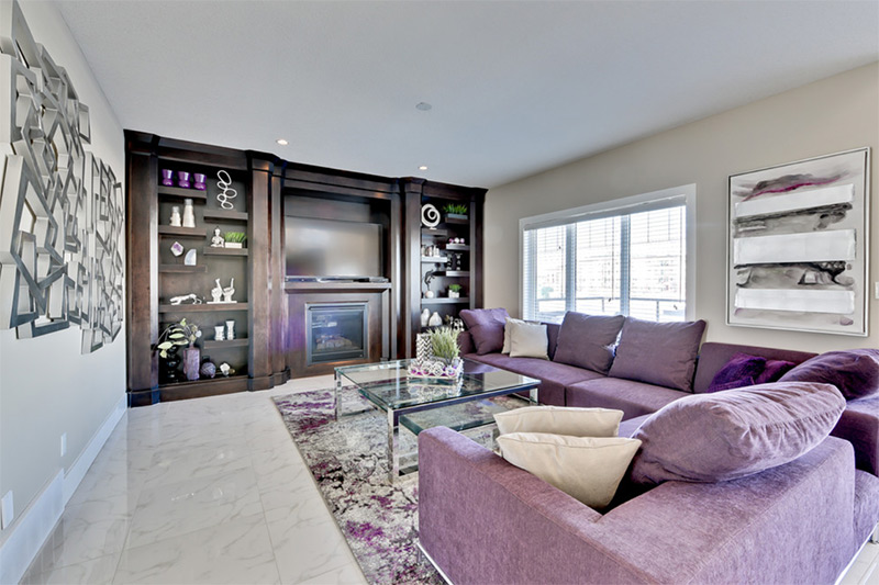 Bright purple sofas with fireplace
