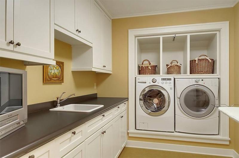 Dark yellow laundry room design