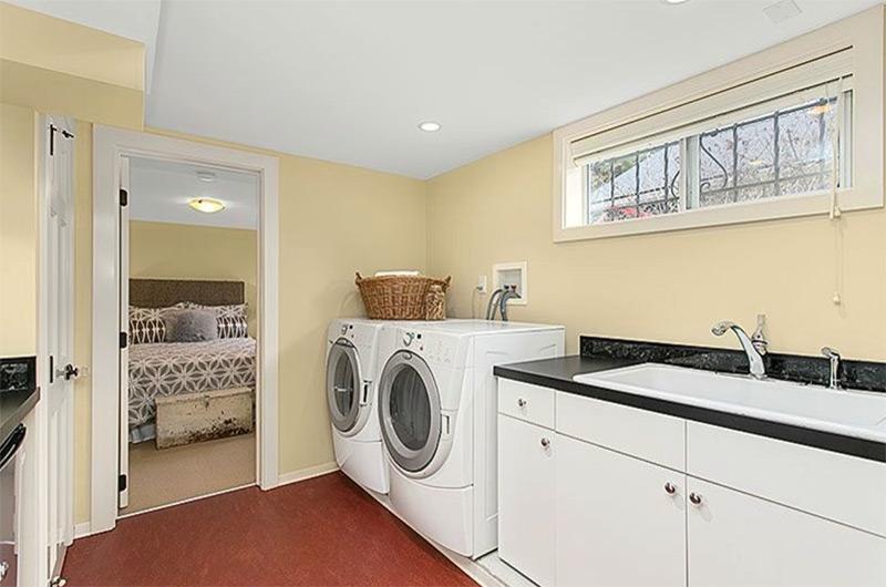 Lower level yellow laundry room interior