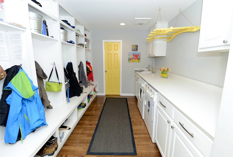 White and yellow laundry room remodel