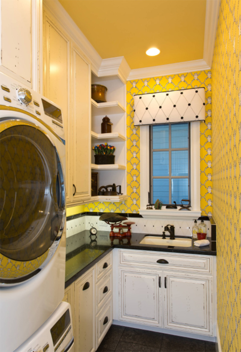 Small laundry room with bright yellow