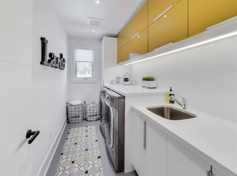 Contemporary narrow laundry room in yellow