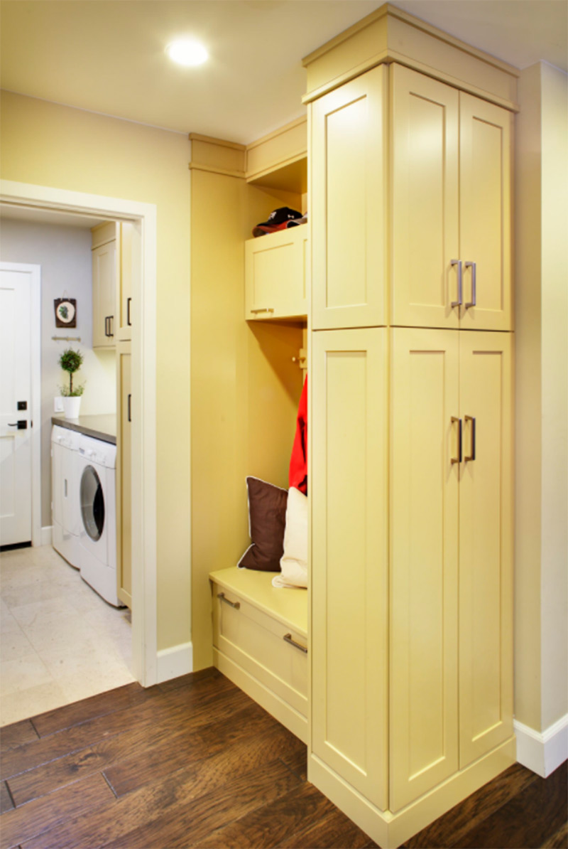 Contemporary laundry room in bright yellow