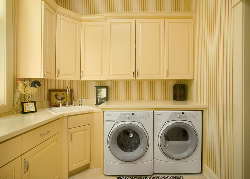 Lake Pointe cottage yellow laundry space