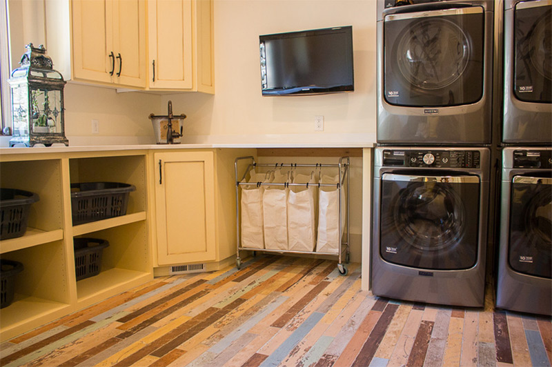 Yellow laundry room with television
