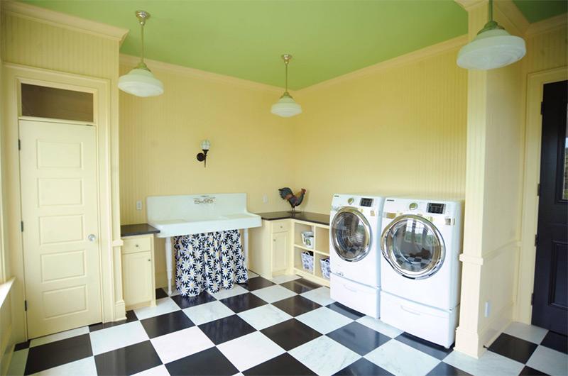 Custom yellow laundry room interior