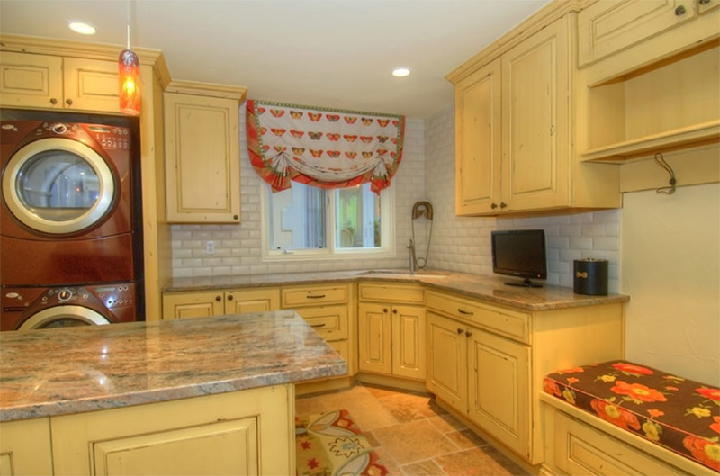 Bright yellow rustic style laundry room