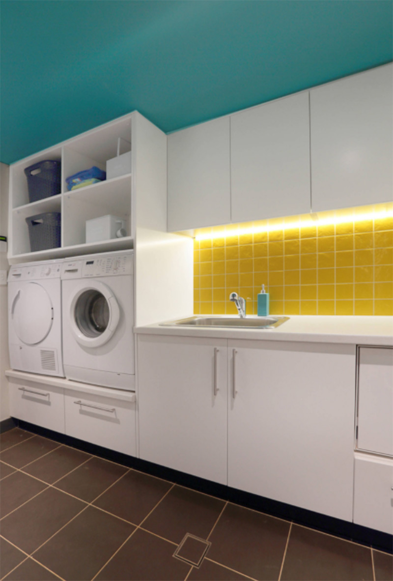 Bungalow laundry room in yellow