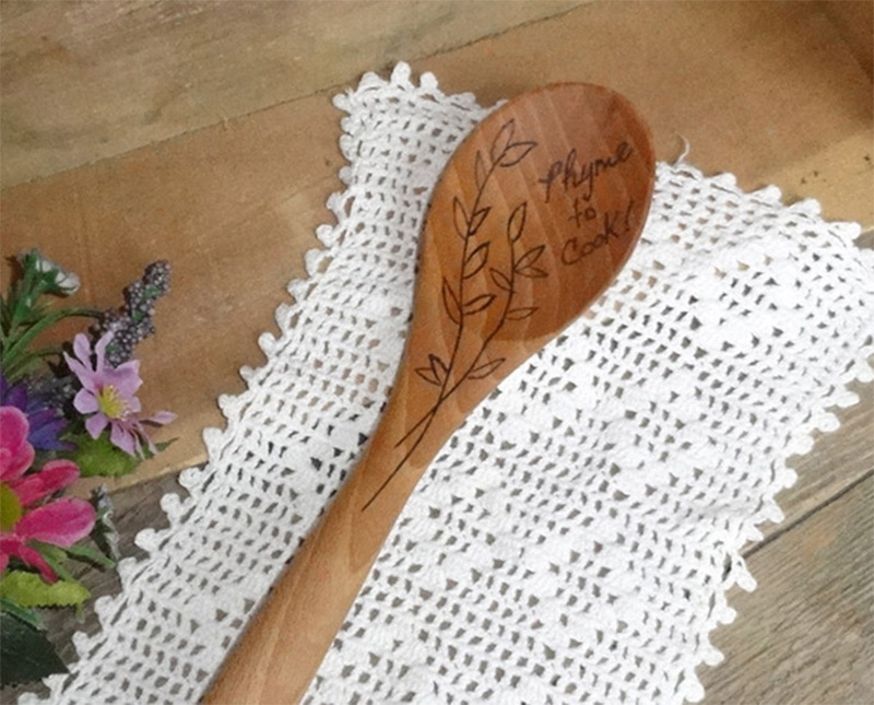 wooden kitchen spoon burnt engraving cooking thyme