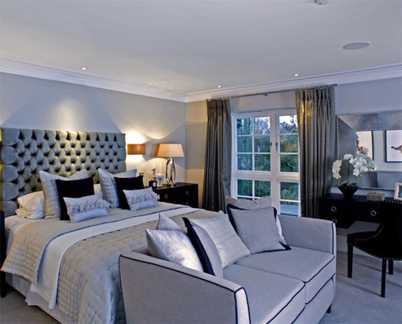 bedroom blue teal in-ceiling speakers lights sofa